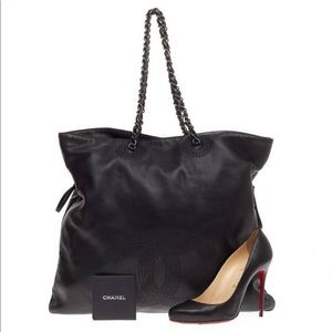 This authentic Chanel Bon Bon Tote Studded Leather